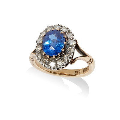 Lot 117 - A synthetic sapphire and diamond cluster ring