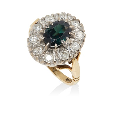 Lot 7 - A sapphire and diamond cluster ring