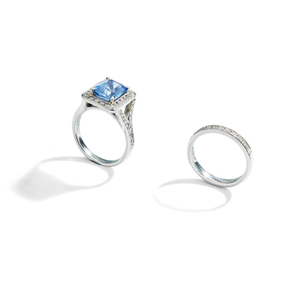 Lot 96 - A sapphire and diamond ring and diamond half-hoop ring