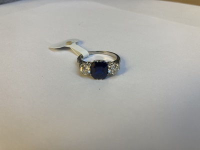 Lot 52 - A sapphire and diamond three-stone ring