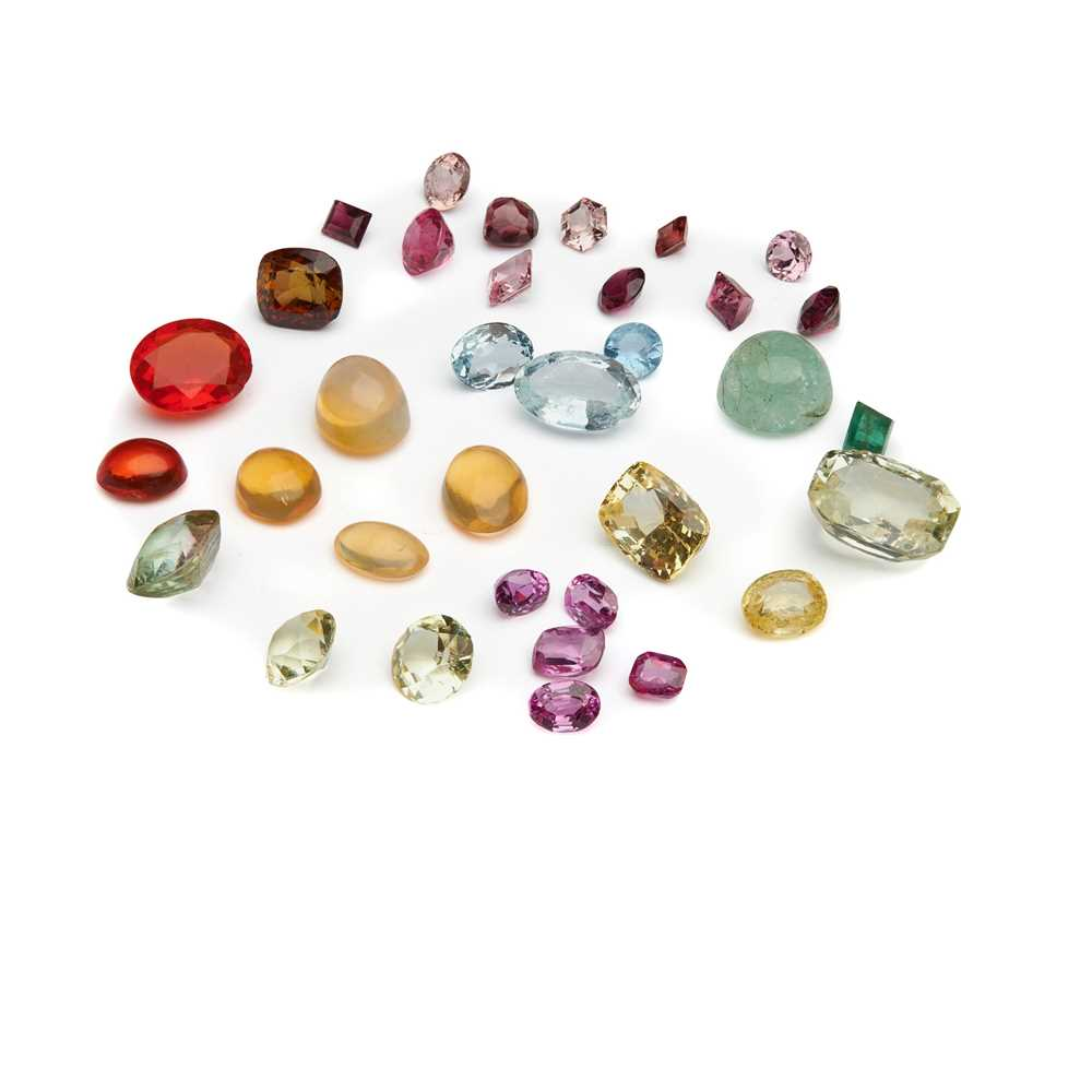 Lot 55 - An unheated yellow sapphire and various loose gemstones