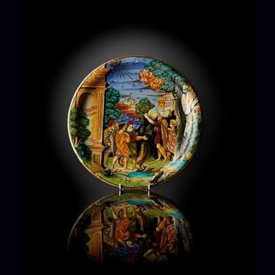 Lot 65 - AN ITALIAN [GUBBIO] ISTORIATA MAIOLICA LUSTRED DISH FROM THE WORKSHOP OF MAESTRO GIORGIO ANDREOLI, EARLY 1530S