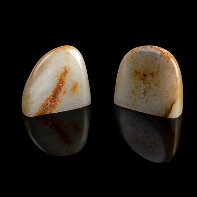 Lot 66 - TWO CELADON JADE WITH RUSSET SKIN SEALS