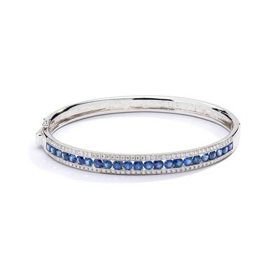 Lot 111 - A sapphire and diamond bangle, by Mappin & Webb