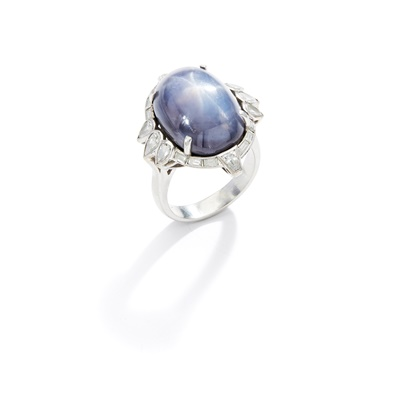 Lot 53 - A star sapphire and diamond ring, 1940s
