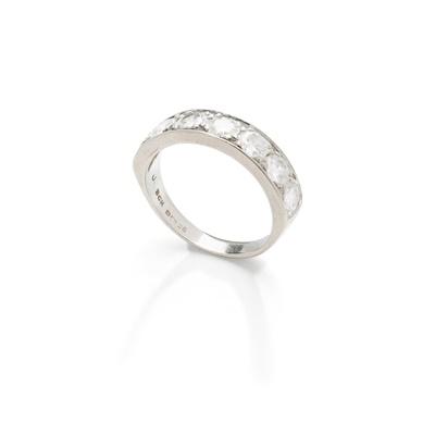 Lot 54 - A diamond half-hoop ring