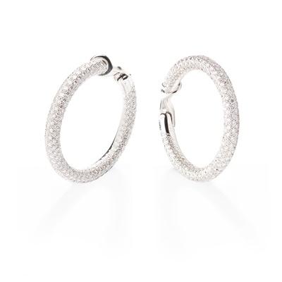 Lot 113 - A pair of diamond hoop earrings, by Chaumet