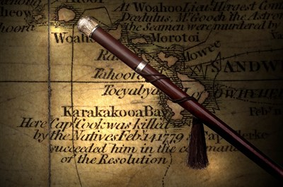 268 - An early 19th century gold mounted hardwood cane,<br/>relating to Capt. James Cook,