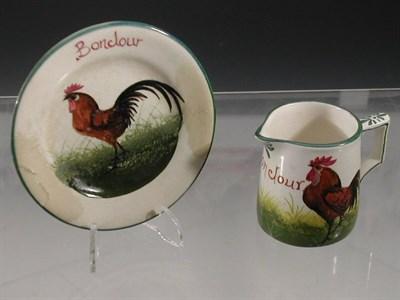Lot 77 - A Wemyss 'Bonjour' jug and plate, the jug...