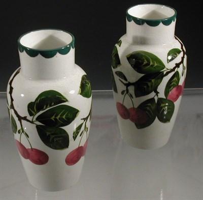 Lot 100 - A pair of Wemyss 'Cherries' Japan vases, each...