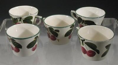 Lot 85 - A set of five Wemyss 'Cherries' tea cups, each...