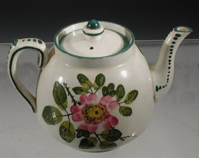 Lot 82 - A Wemyss 'Dog Roses' teapot and cover, of...