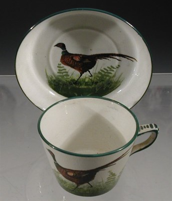 Lot 80 - A Wemyss 'Pheasant' cup and saucer, each...