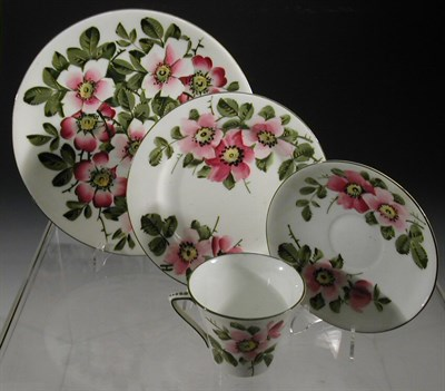 Lot 84 - A Wemyss 'Dog Roses' circular cake plate,...
