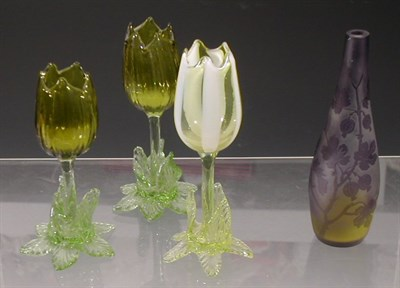 Lot 50 - A matched set of three tulip glass vases, each...