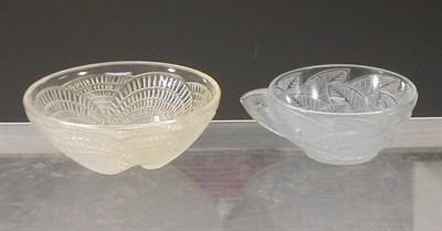 "Lot 42 - ""Coquilles"", a Lalique opalescent glass bowl,..."