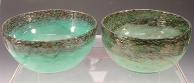 Lot 13 - Two Monart circular glass bowls, each with...