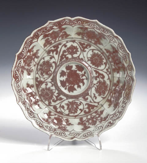 85 - Sold for £38,000<br/>A rare Chinese porcelain circular scalloped underglaze copper red cup stand, Yuan, early Ming dynasty