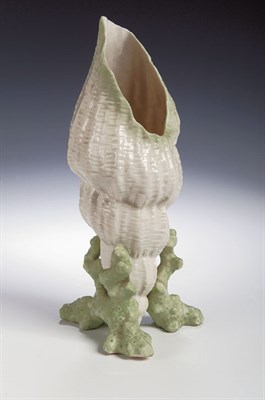 Lot 79 - A Belleek vase, in the form of an upturned...