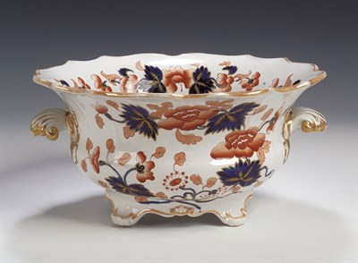Lot 68 - An English scalloped and fluted twin handled...