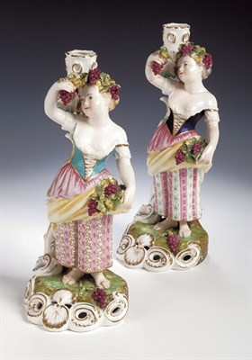 Lot 91 - A pair of Derby figural candlesticks, each in...