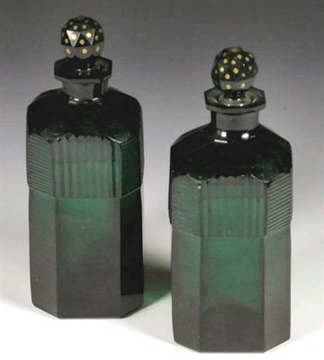 Lot 53 - A pair of Regency green glass decanters and...