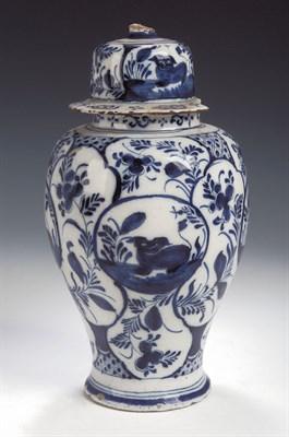 Lot 85 - A Dutch Delft blue painted globular vase and...