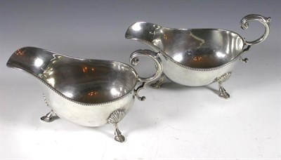 Lot 15 - A pair of silver sauce boats, with marks for...