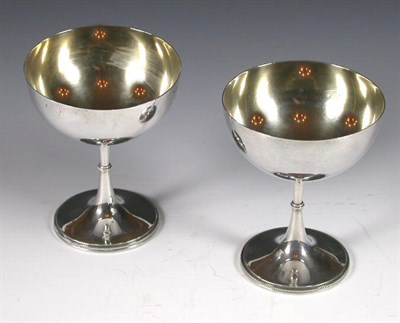 Lot 23 - A pair of Victorian parcel gilt silver...