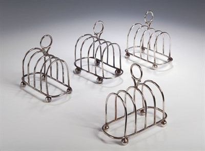 Lot 22 - A set of four silver toast racks, with marks...