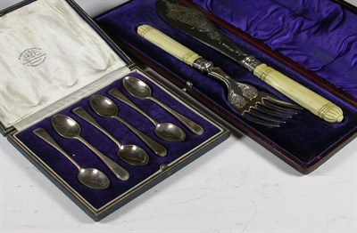 Lot 24 - A pair of Victorian silver fish servers, with...