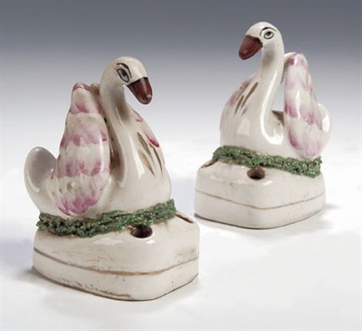 Lot 94 - A pair of 19th century Staffordshire swan pen...
