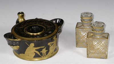 Lot 44 - A black glass and gilt inkwell